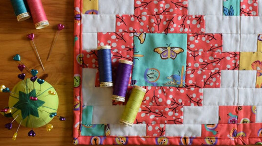 quilt and pin cushion