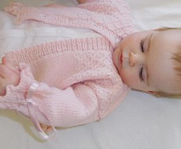 Baby girls sweater with detailed bodice and frilled hemline and cuffs