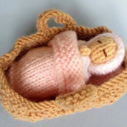 Tiny Baby Doll in a Basket Crib
