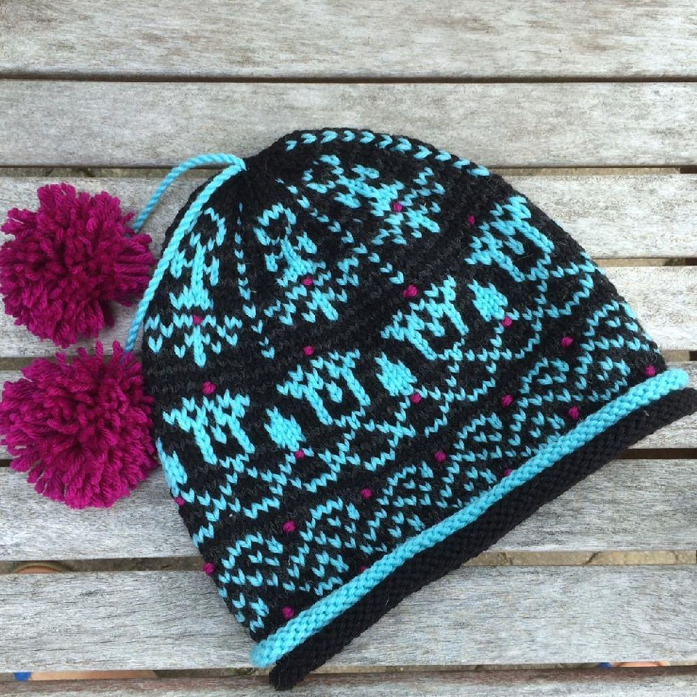 Sesen Lotus Flower Hat Knitting pattern by Idle Hands ...