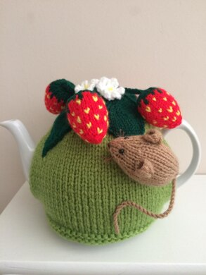 Nature tea cosy. Animal tea cosy .Pesky mouse in the strawberry patch