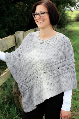 Poncho with cable pattern