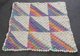 Rainbow Dreams Baby Afghan in Crystal Palace Yarns Mochi Plus and Plus Solid