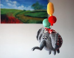 Airy-Fairy Flying elephant with 3 balloons ( knitted round )