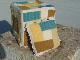 Knitted patchwork cushion, footstool, draught excluder, rug, living room collection