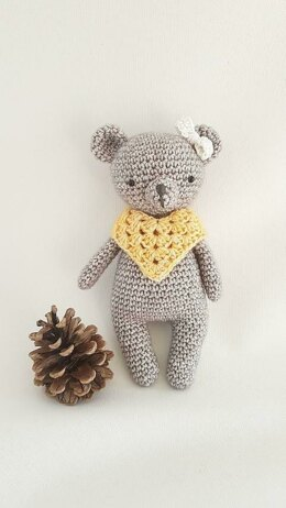 Bear with poncho and bow