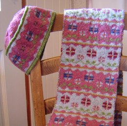 Flowers in winter scarf and hat