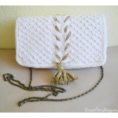 White knit clutch with gold tassel