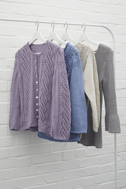 Collection of cardigans on coat hangers