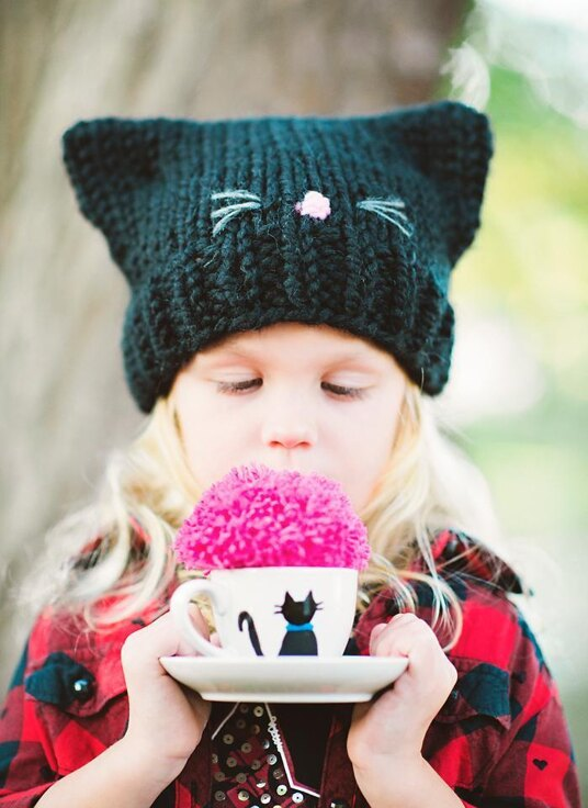 little girl in kitten hat