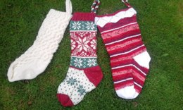Three traditional knitted Christmas stockings