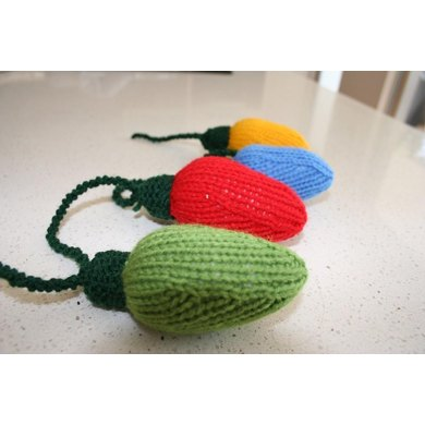 4 Christmas knitting patterns - baubles, gift, lights and crackers