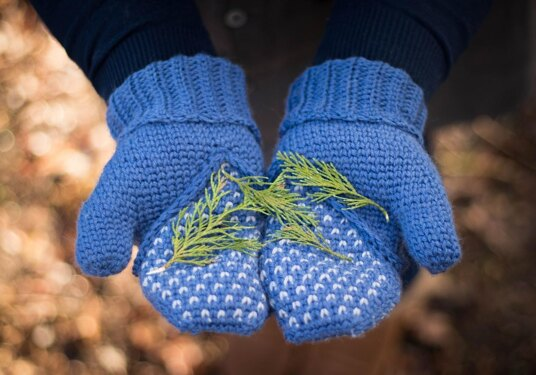 Blue crocheted mittens with leaves