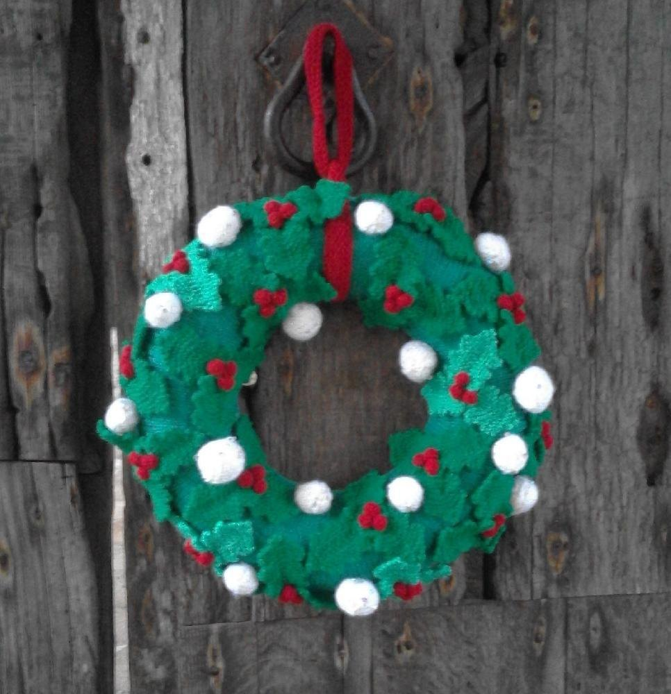 Knitted Christmas wreath with holly leaves, berries and snowballs ...