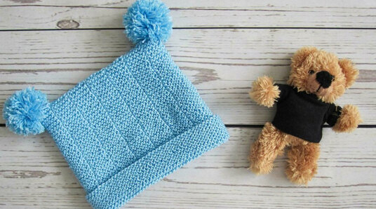 blue bobble beanie and teddy bear