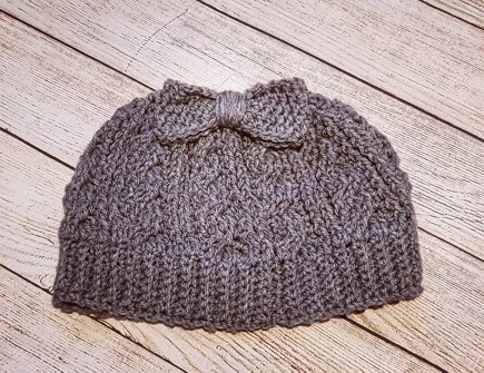 Cabled messy bun hat crochet project by Holly C  705a22c477b