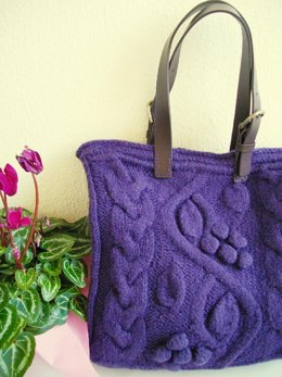 Purple bag with bobbles and cables