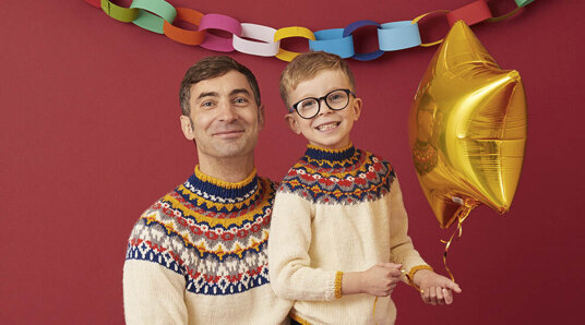 father and son in matching jumpers