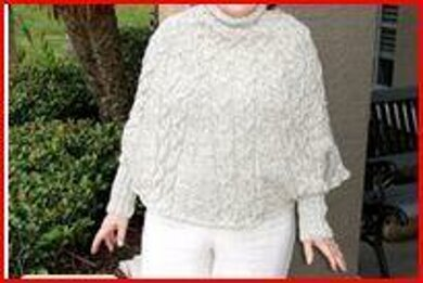 Cabled poncho with cuffs