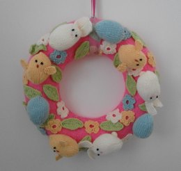 Knitted Easter wreath with chicks and bunnies
