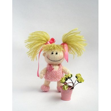 Small funny gardener Doll in the pink dress