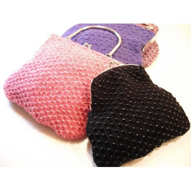 Beaded clutch and handled bags