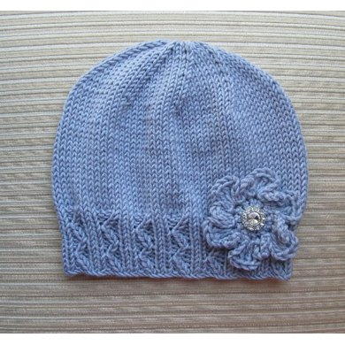 Zig Zag Hat Knitting Pattern : Lilac Hat with Zig Zag Ribbing and a Crochet Flower for a ...