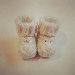 Baby booties with owl detail