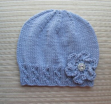Lilac Hat with Zig Zag Ribbing and a Crochet Flower for a Lady
