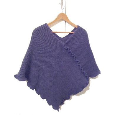 Knitted adult poncho with crochet trim