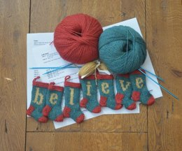 BELIEVE Set of 7 Christmas Stocking Ornaments