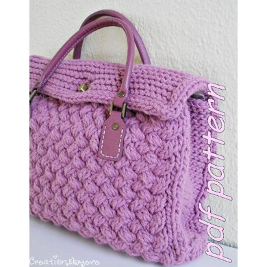 Textured bag knitted with woven pattern