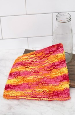 Wrapped Stitches Washcloth in Red Heart Scrubby Smoothie Multi - LM5935