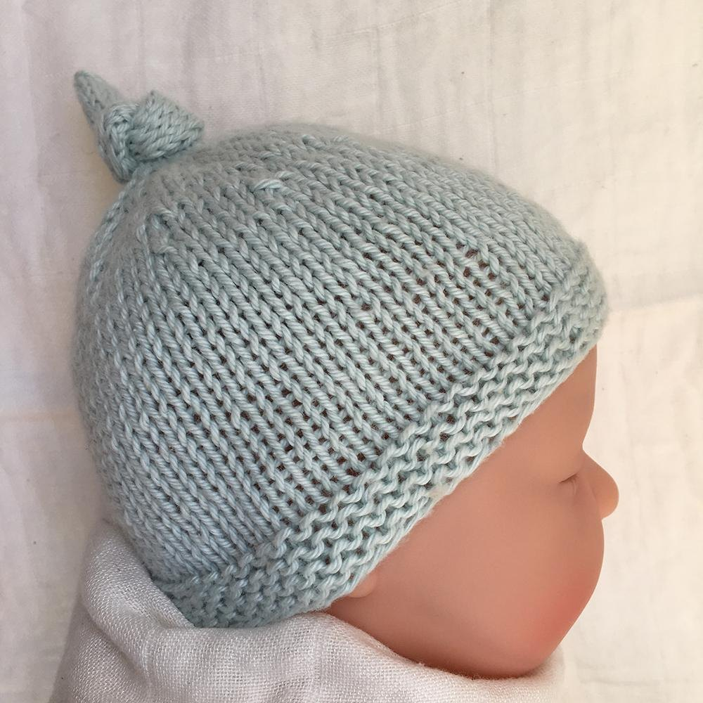 1aef3d78a0d Tegan Baby Hat with Top Knot Knitting pattern by Julie Taylor