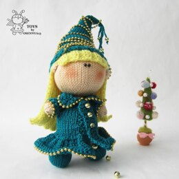 Pebble doll in the Christmas Tree dress