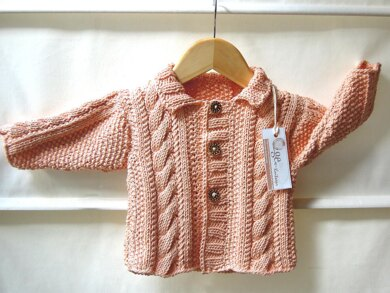 Jacket with cables and moss stitch panels - P019