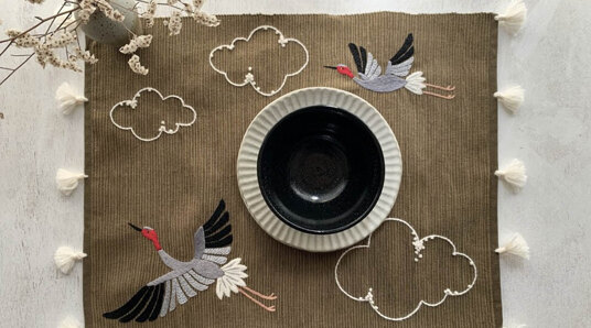 placemat embroidered with cranes