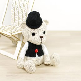 Teddy bear in a top hat and vest