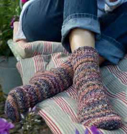 Socken im Zopf-Rippenmuster Socks in Regia 4-Ply Countrylife Color