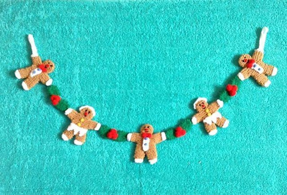 Gingerbread Man Jumper Knitting Pattern : Christmas Gingerbread Man Garland Knitting pattern by Andrew Lucas