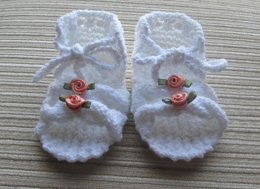 Knitted Sandals with Cables for a Baby Girl